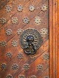 Old-fashioned door with doorhandle Royalty Free Stock Photo