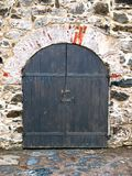 Old-fashioned door with doorhandle Stock Images