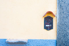 Old fashioned doorbell on orange wall Royalty Free Stock Image
