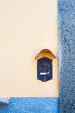 Old fashioned doorbell on orange wall Stock Photos