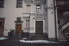 Old fashioned doors in classic style on old building facade stock image