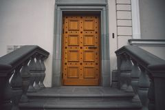 Old fashioned doors in classic style on old building facade background royalty free stock photo
