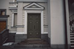 Old fashioned doors in classic style on old building facade background royalty free stock photos