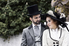 Old fashioned dressed couple in the park Stock Photography