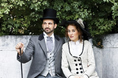 Old-fashioned dressed couple in the park Stock Photo