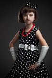 Old-fashioned dressed little girl Stock Photography