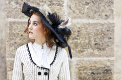 Old-fashioned dressed woman with vintage hat Royalty Free Stock Photography