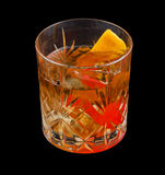 Old Fashioned drink. Consisting of bourbon, sugar cube, angostura bitters and soda water. Isolated on black background royalty free stock images