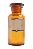 Old fashioned drug bottle with label, isolated. Stock Photography