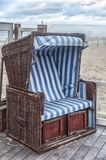 Old-fashioned Dutch beach chair near the beach stock images