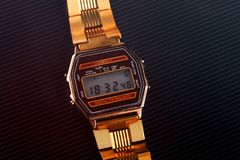 Old-fashioned electronic wristwatch on black background. Toned Stock Images