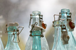 Old fashioned empty glass bottles closeup Royalty Free Stock Image