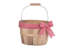 Old fashioned empty wooden basket with plaid ribbon isolated on Stock Photos