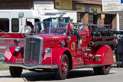 Old fashioned Engine Co. On Memorial day an American flags are displayed patriotically on an old-fashioned fire truck in New Hyde Park NY prior to the parade Royalty Free Stock Image