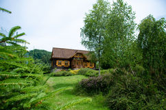 Old fashioned european log wooden cottage Royalty Free Stock Image