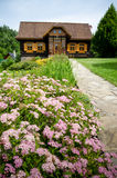 Old fashioned european log wooden cottage Stock Photo