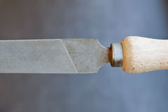Old fashioned file with wooden grip. Closeup of old fashioned file with wooden grip Stock Image