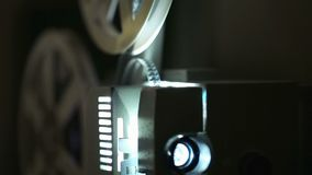 Old-fashioned film projector. Old-fashioned antique film projector close up stock footage