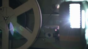 Old-fashioned film projector. Side view of an old-fashioned antique film projector stock footage