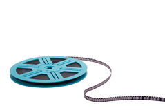 Old Fashioned Film Reel S-Curve. An old-fashioned blue film reel unrolling, isolated on white Royalty Free Stock Image