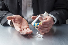 Old fashioned flask of pills for symbol of healthcare as pharmacy business Stock Photo