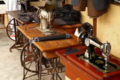 Old Fashioned Foot Powered Sewing Machines. 3 old fashioned manual foot powered sewing machines being used by tailors on a street in Arusha, Tanzania royalty free stock photography