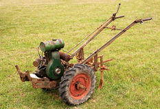 Old-fashioned garden tiller or rotovator Royalty Free Stock Image
