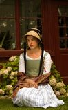 Old-fashioned girl. Thoughtful, maybe sad, young girl in old-fashioned dress Stock Photos