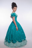Old fashioned girl in cyan dress Stock Image