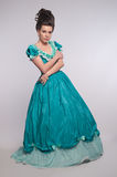 Old fashioned girl in cyan dress Stock Images