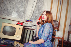 Old fashioned girl speaking telephone. Old fashioned girl in USSR style speaking telephone Royalty Free Stock Photography