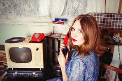 Old fashioned girl speaking telephone. In USSR style Royalty Free Stock Photo