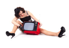 Old-fashioned girl watching tv. Picture of old-fashioned girl watching old tv Royalty Free Stock Photo