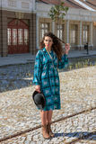 Old-fashioned girl wearing blue retro vintage dress and hat Royalty Free Stock Image