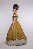 Old fashioned girl in yellow dress Royalty Free Stock Photography