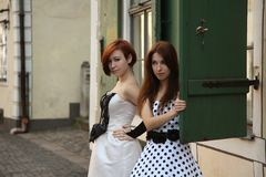 Old-fashioned girls Royalty Free Stock Photo