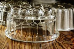 Vintage Glass and Metal Jelly Moulds. Old fashioned glass and aluminum jelly or blancmange moulds for making traditional jellies stock photo