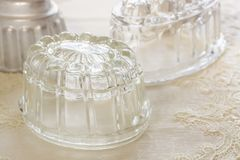 Vintage Glass Jelly Moulds. Old fashioned glass jelly or blancmange moulds for making traditional jellies stock image