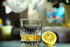 Old fashioned glass with lemon. Rum and ice Stock Photography