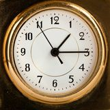 An old fashioned golden clock. Macro Stock Photography