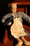 Old fashioned hand-stiched doll. Old fashioned doll that has been hand-stiched with care,in old clothes with button eyes and drawn on face Royalty Free Stock Images