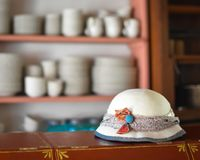 Old Fashioned Hat on Ledge in Kitchen Stock Image