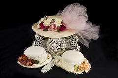 Old Fashioned Hats. A collection of old fashioned hats with flowers,lace and netting Royalty Free Stock Images