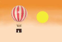 Old fashioned helium balloon in the sky with fantastic sunset. Stock Photos