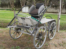 Old-fashioned horse carriage with green grass background Royalty Free Stock Photo