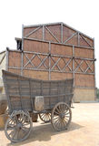 Old-fashioned horse cart. And big wooden warehouse Royalty Free Stock Image
