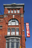 Old fashioned hotel. Old fashioned brick hotel and sign Stock Images