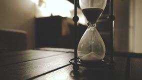 Old Fashioned Hourglass Counting Classic Sand Clock  In Dark Night Atmosphere Cinematic Warm Feel Time Goes Closeup