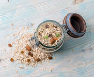 Old fashioned jar full of oatmeal, topview. Old fashioned jar full of oatmeal with some raisins and dry fruits open, topview Royalty Free Stock Photo