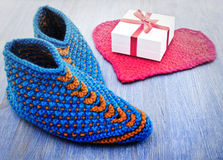 Old fashioned knitted slippers Stock Photography